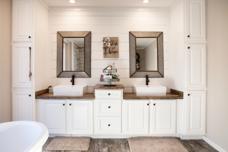 Manufactured home farmhouse themes double vanity in primary bathroom.