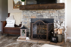 Manufactured home stone fireplace with wood accents.