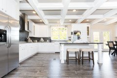 Manufactured home kitchen with coffered ceilings and a large kitchen island.