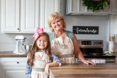 Women and young girl in the kitchen of their manufactured home.