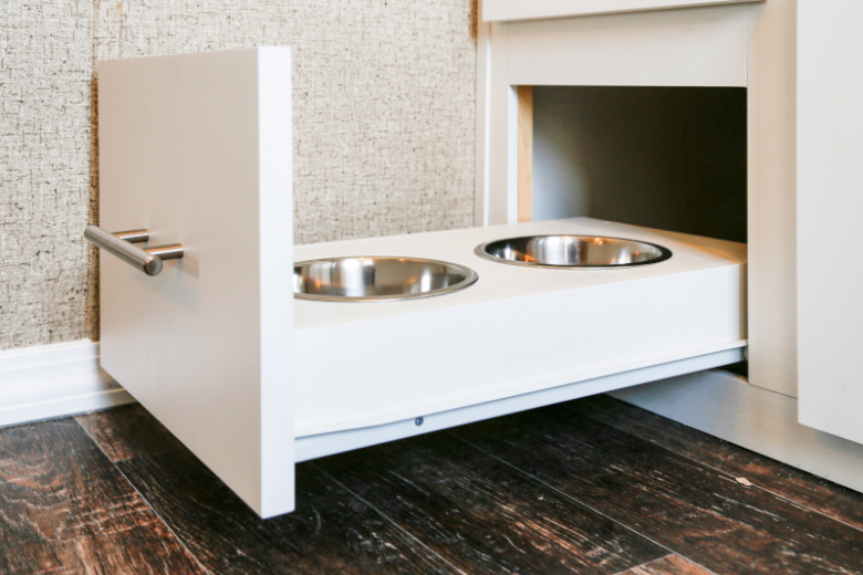 Hideaway pet food dishes in white cabinetry
