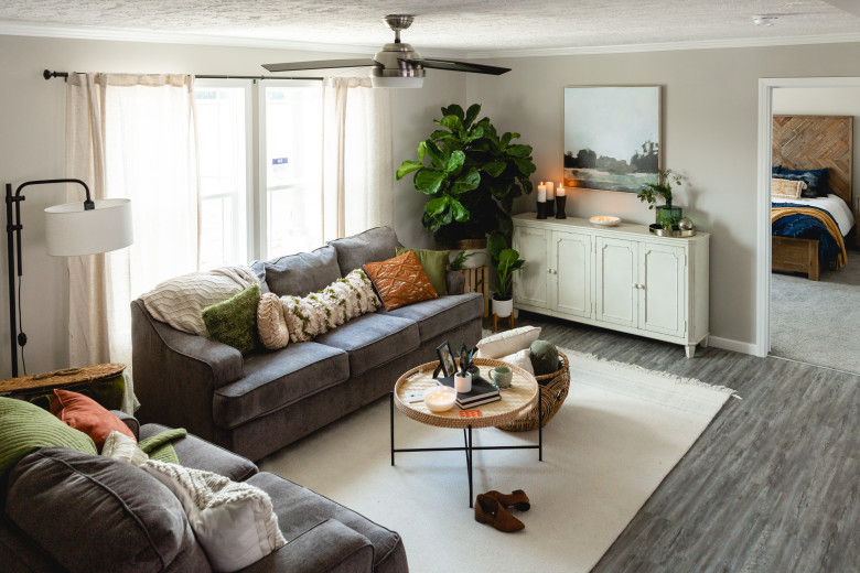 Living room of the Ripley (25BLD28583AH) with gray couches and other bohemian style décor.