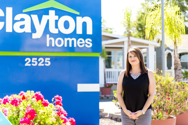 A home consultant at a Clayton home center that is ready to show customers a selection of manufactured homes.