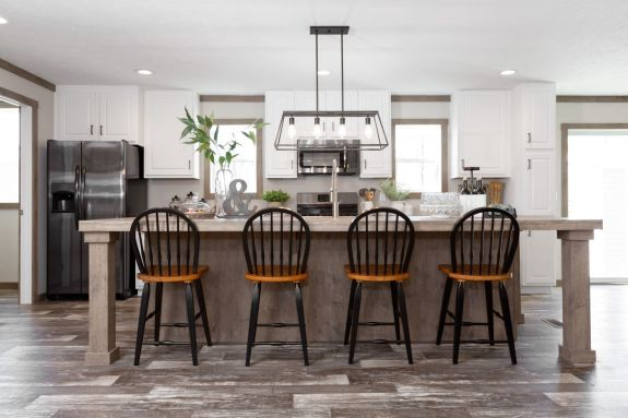 Pick a seat at this large island in the Isabella and enjoy the unity that a beautiful open kitchen can bring.