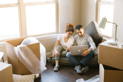 Couple on their computer in their new manufactured home.