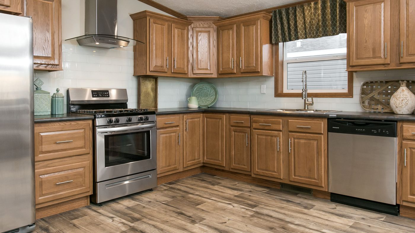 Manufactured homes featuring wood cabinets in a kitchen.