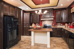Kitchen of the Sunburst model with island feature and dark cabinetry.