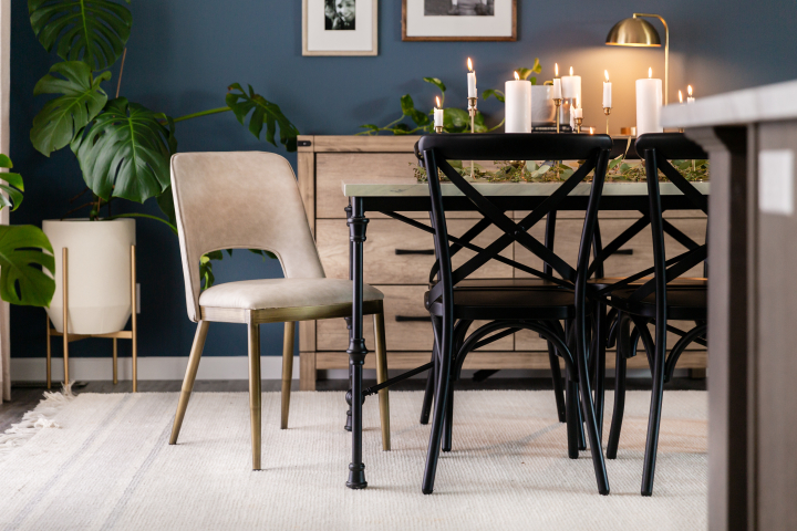 Dining room of the Ripley (25BLD28583AH) with candlelit display and black and neutral toned furniture and accents.