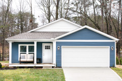 Blue new class Clayton home with attached garage