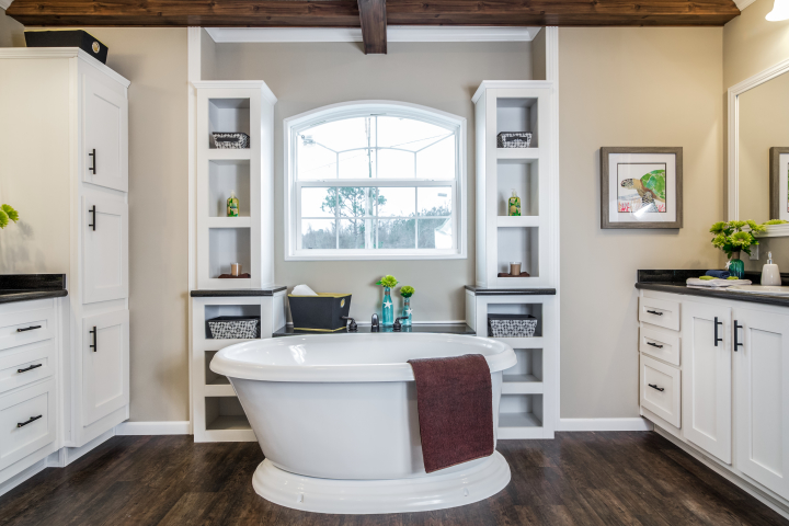 Primary bathroom of the Lloyd with large soaker tub and built-in storage.