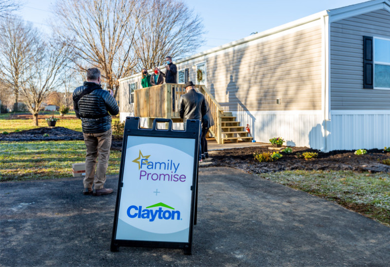 Clayton and Family Promise gather around for the Alcoa Home Donation