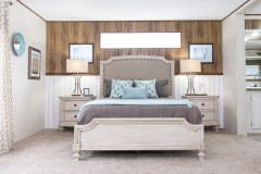 Master bedroom of the Stockton home, with wooden and shiplap wall décor.