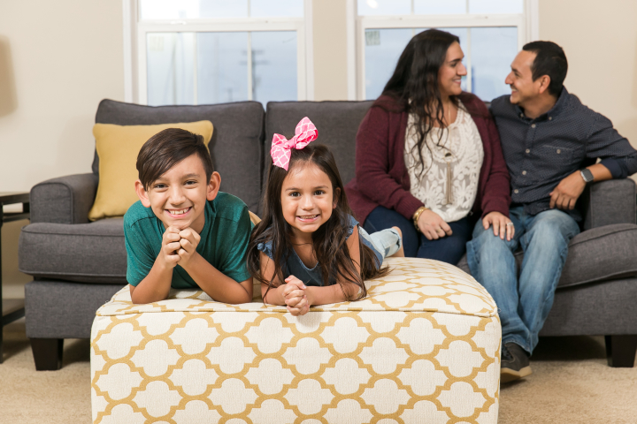 Family gathered in the living room of a manufactured home making memories together.