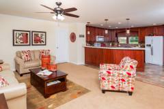 Wide shot of living room and kitchen areas of The McCutchen Model by Buccaneer.