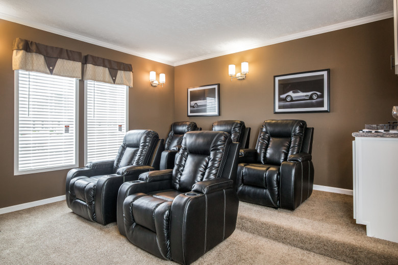 Theater room of the Lloyd with four large black leather recliners.