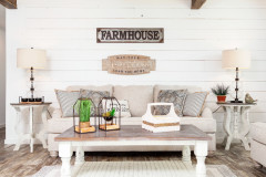 Manufactured home with a farmhouse styled living room and white shiplap walls.