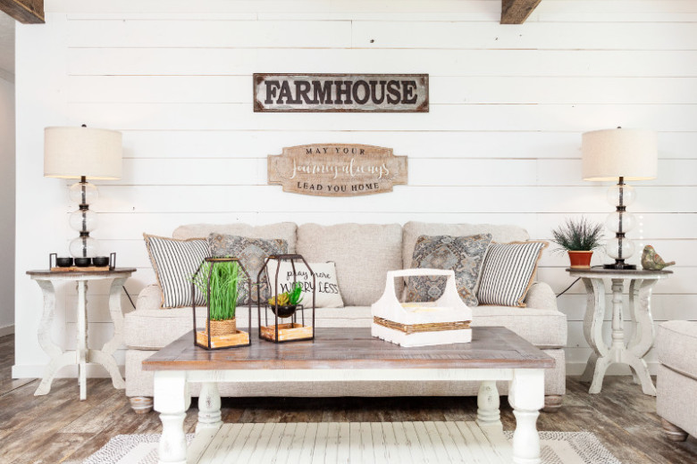Manufactured home living room decorated with farmhouse features and a shiplap accent wall.