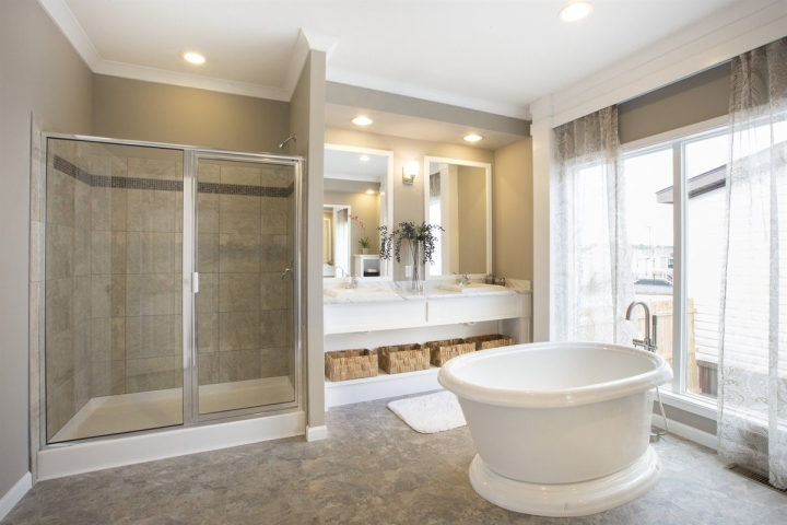 Free standing garden tub beside a large walk in shower of a manufactured home bathroom