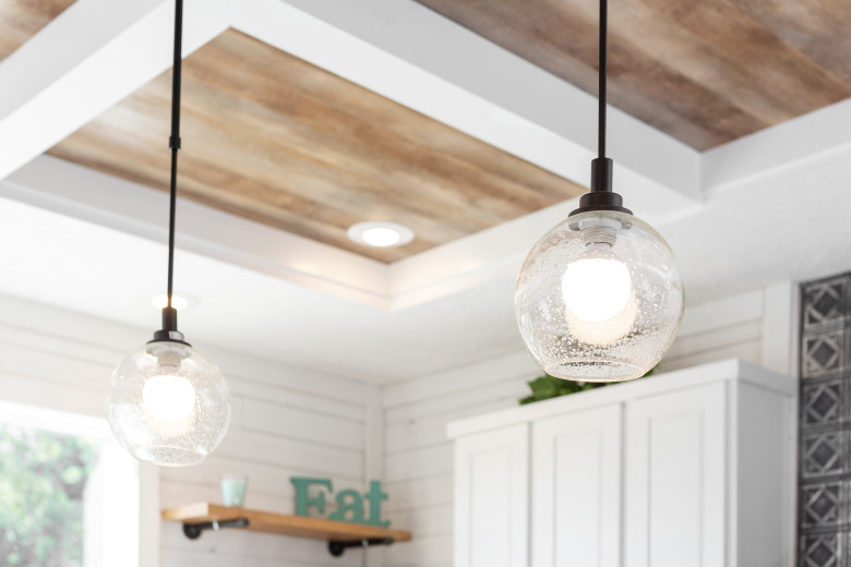 Glass pendant lighting in the kitchen of a Clayton Built® home.