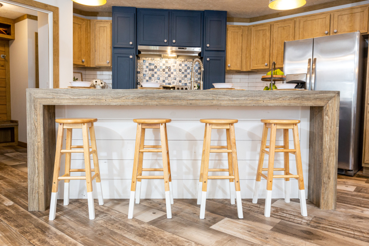 Kitchen of the Kimmel model with a shiplap-front kitchen island.