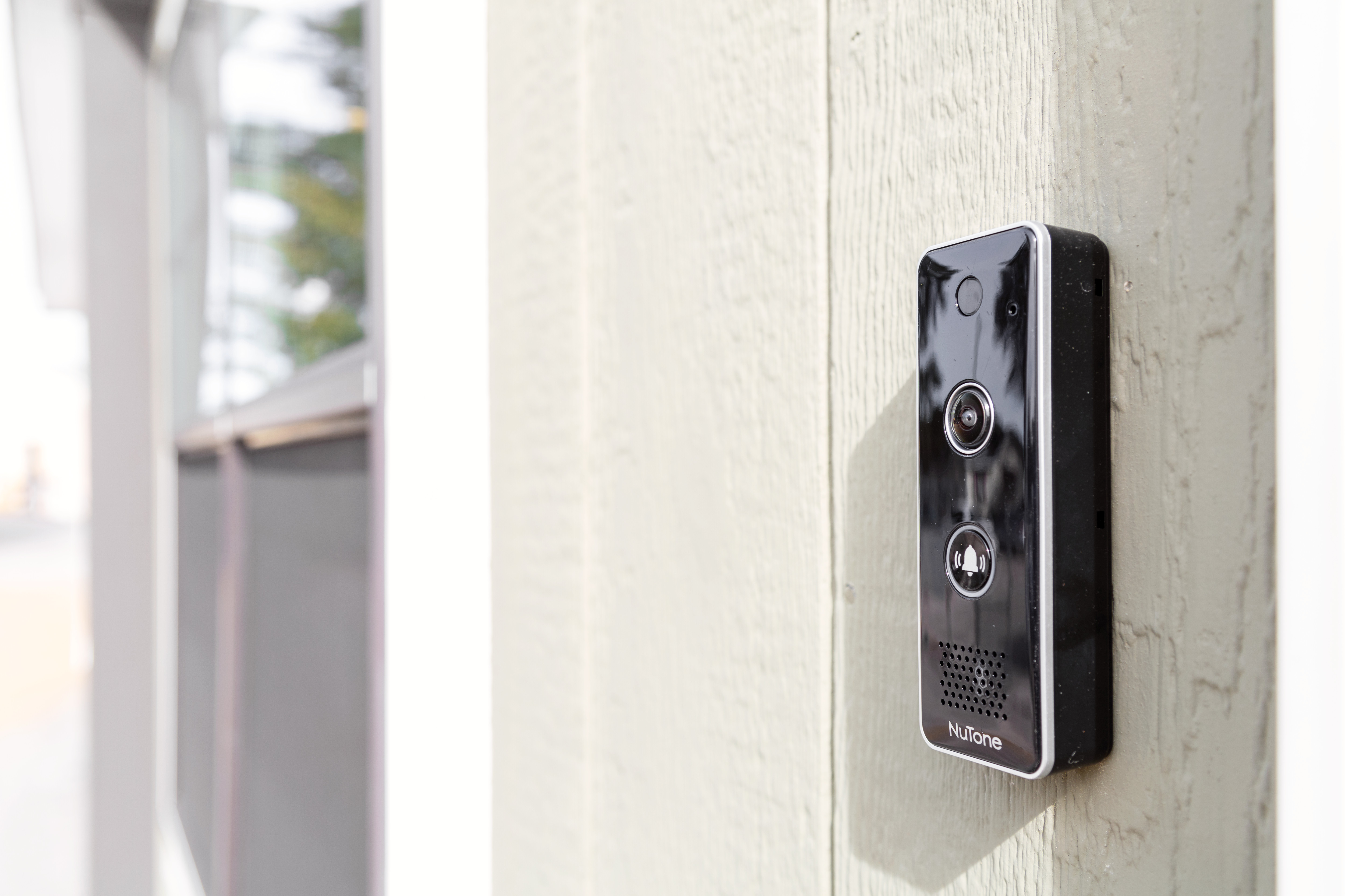 Smart video doorbell with a sleek black look on the side of a manufactured home.