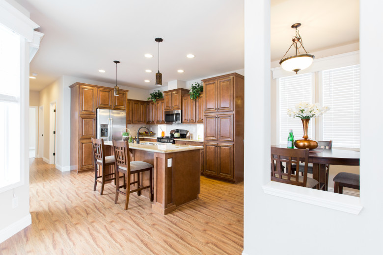 Beautiful manufactured home kitchen with island and wood cabinets.