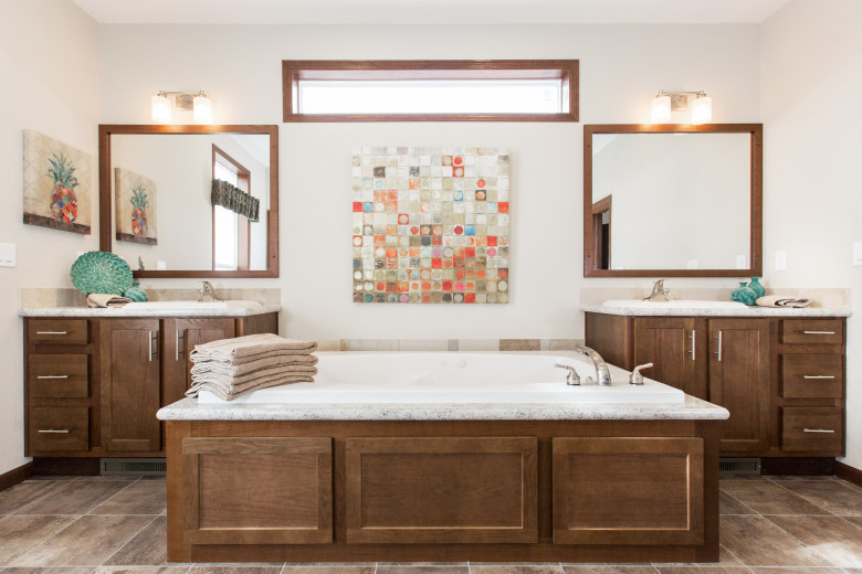 Manufactured home bathroom featuring soaker tub.