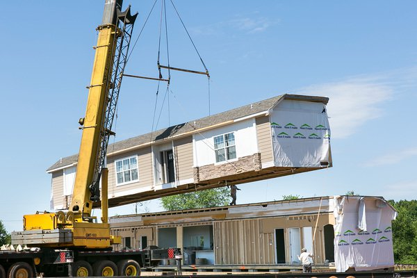 Fountain family manufactured home being crane set on their property
