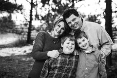 Black and white picture of Clayton employee and her family.