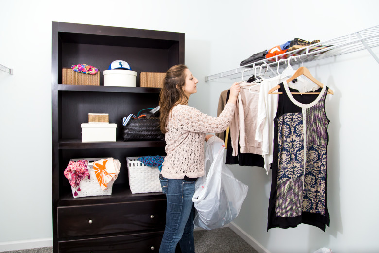 Woman organizing a closet in a manufacture home