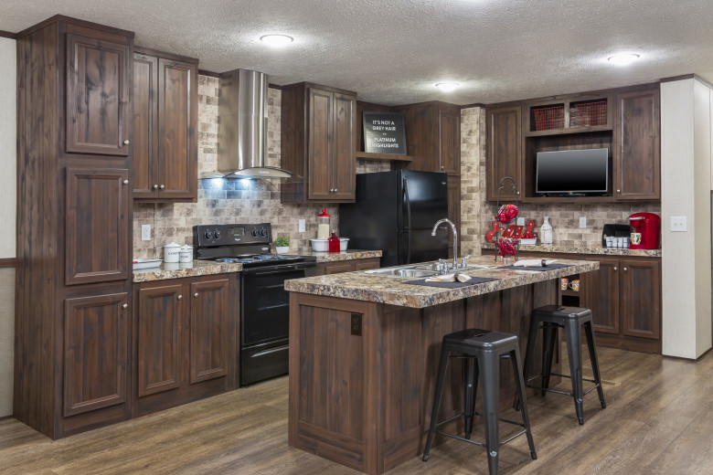 A large kitchen with black appliances and lots of cabinets.