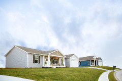 Manufactured home neighborhood with large front yards.