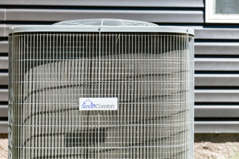SmartComfort® air conditioning unit outside of a manufactured home.