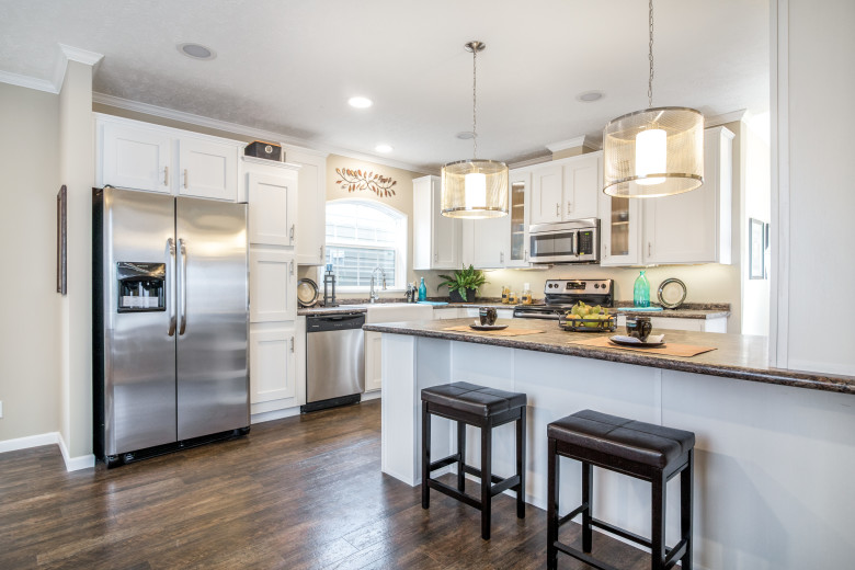 Kitchen of the Lloyd with large island and stainless steel appliances.