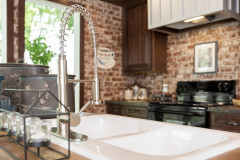 Faucet and double basin sink in the Avalyn's kitchen.