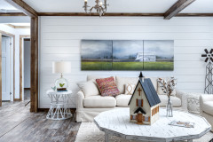 Mobile home living room with white shiplap wall.