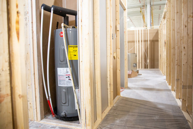 A Rheem® water heater in a manufactured home that is still under construction.