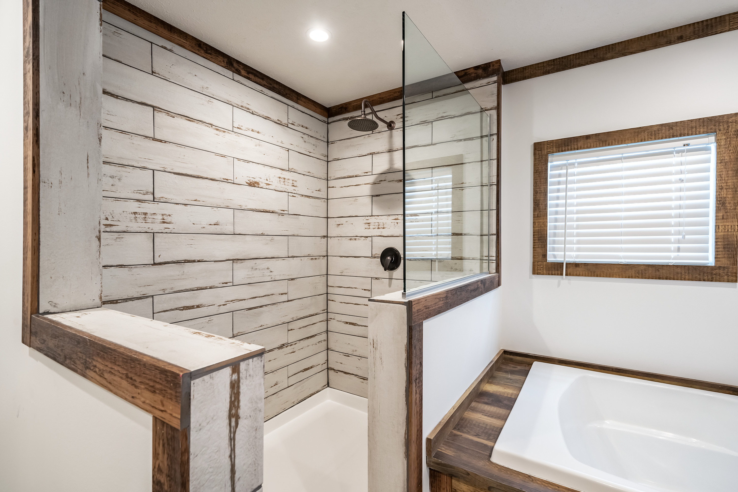 Large manufactured home bathroom with antiqued wood inside a large walk-in shower.
