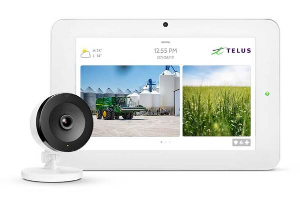 Security camera and tablet showing security footage of a farm