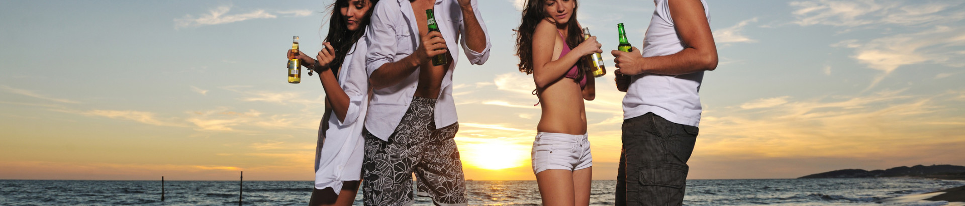 hot-girls-and-guys-partying-by-the-beach-at-sunset-IST