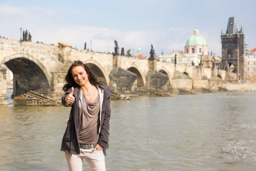 Travel Agency - Girl standing riverside