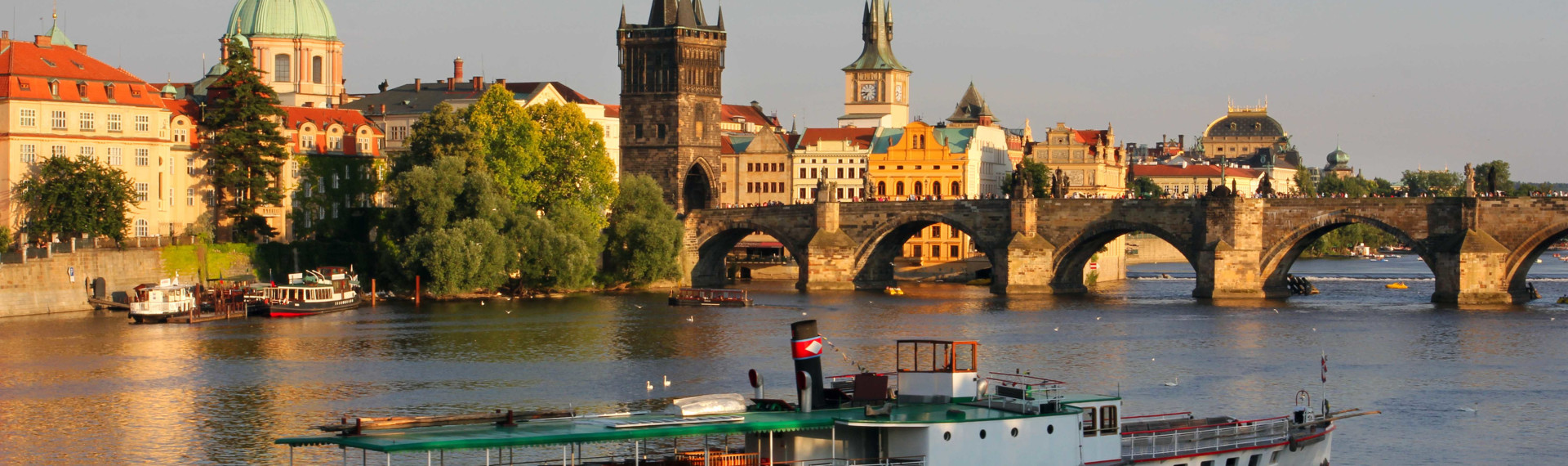 prague river and charles bridge