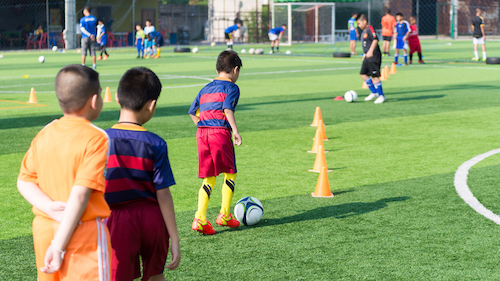 kids participating in a youth soccer camp