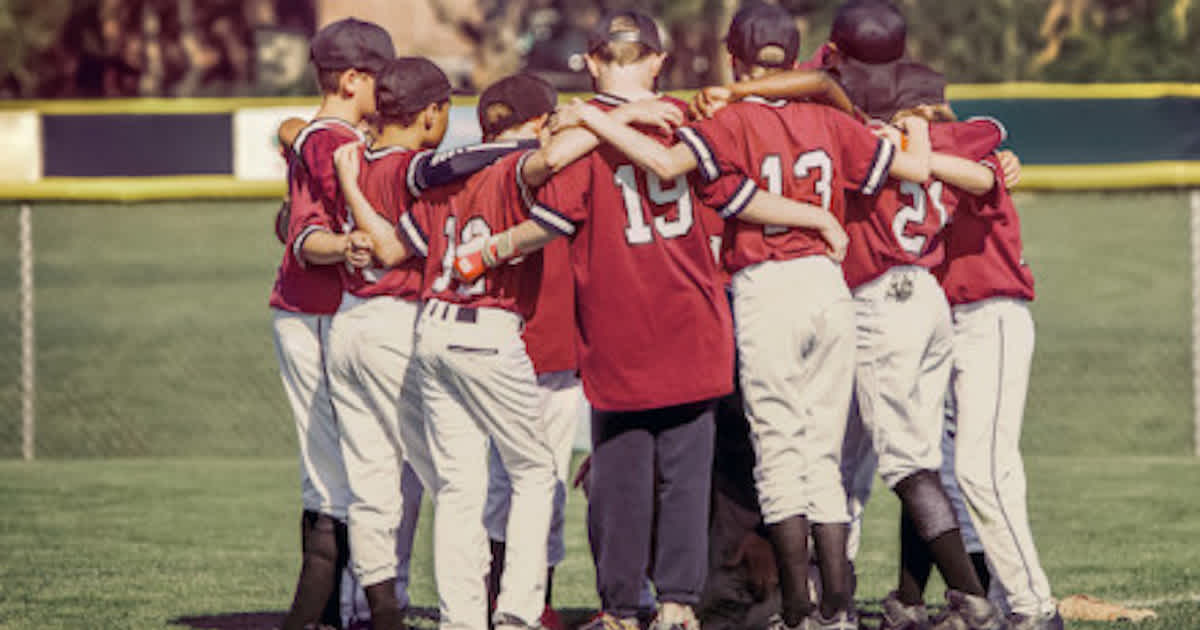 a youth travel baseball team getting ready for a game