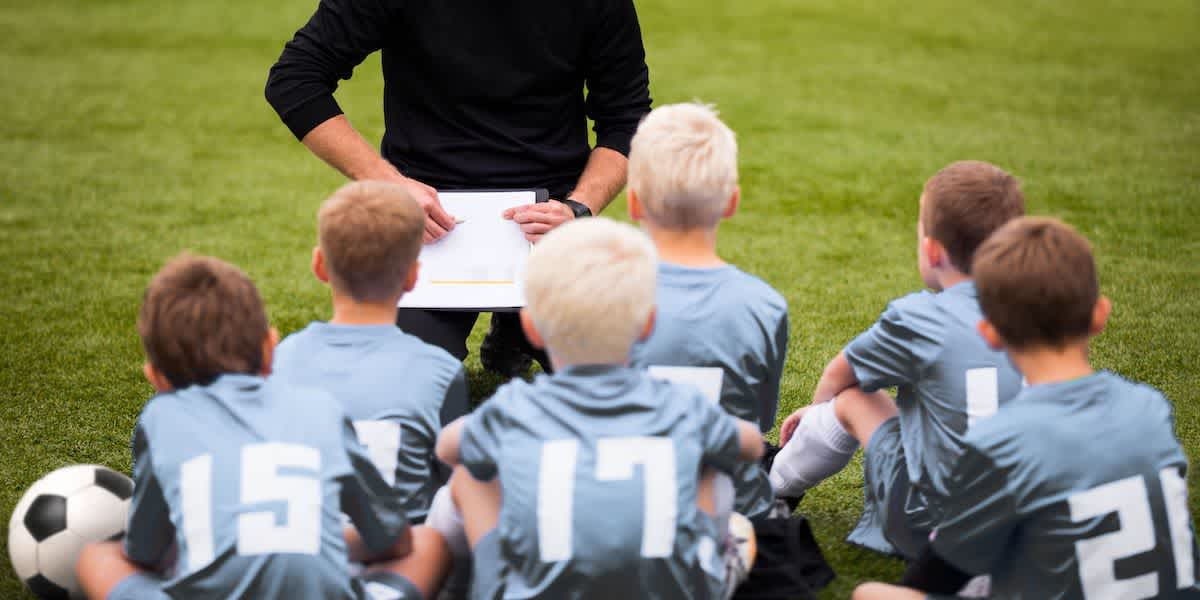 a youth soccer coach working with players