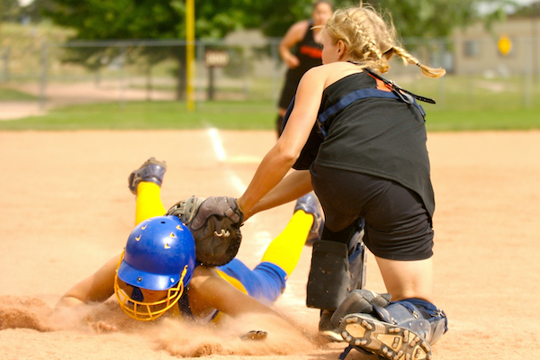 youth softball player slide