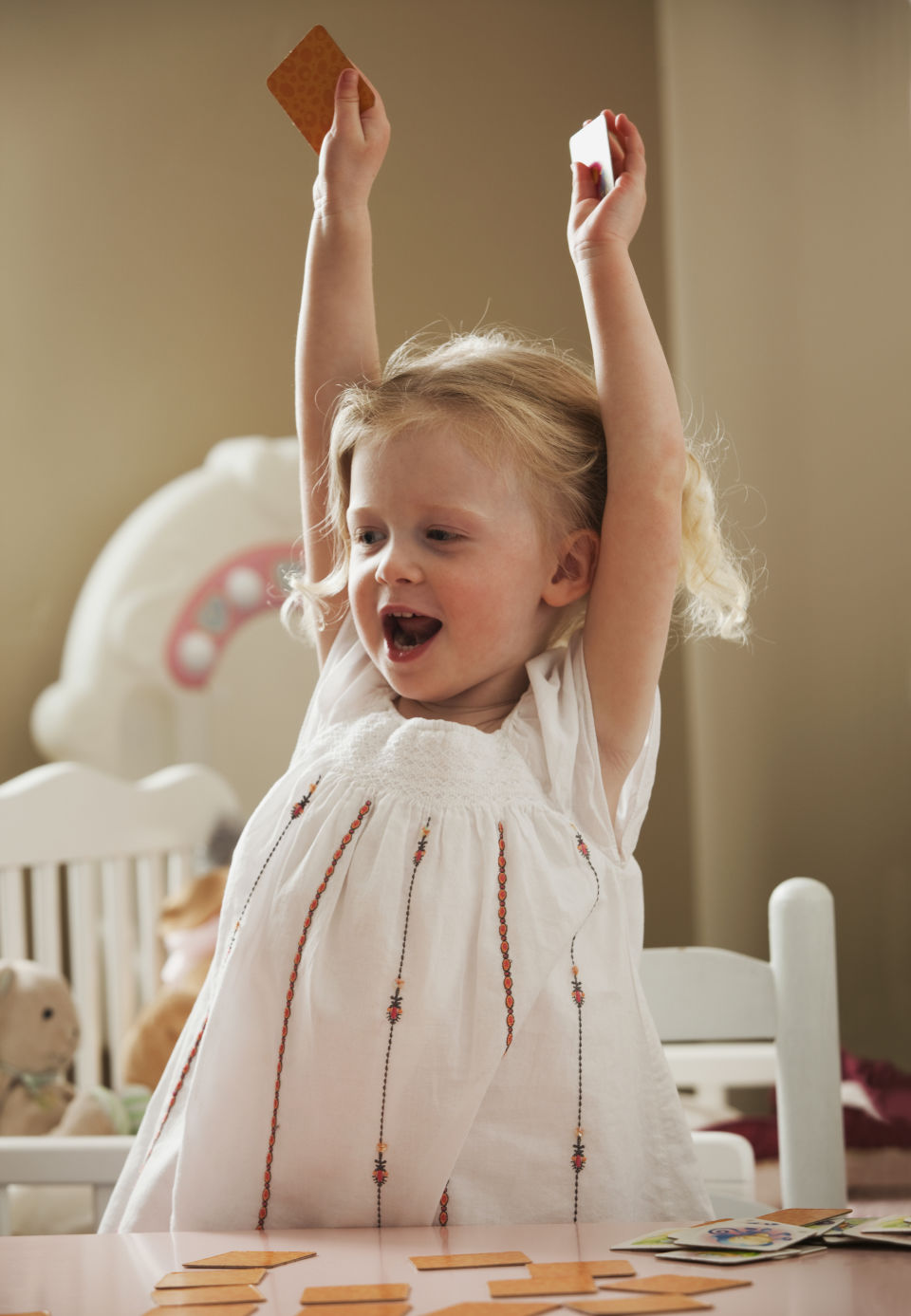 Girl throwing arms up excited