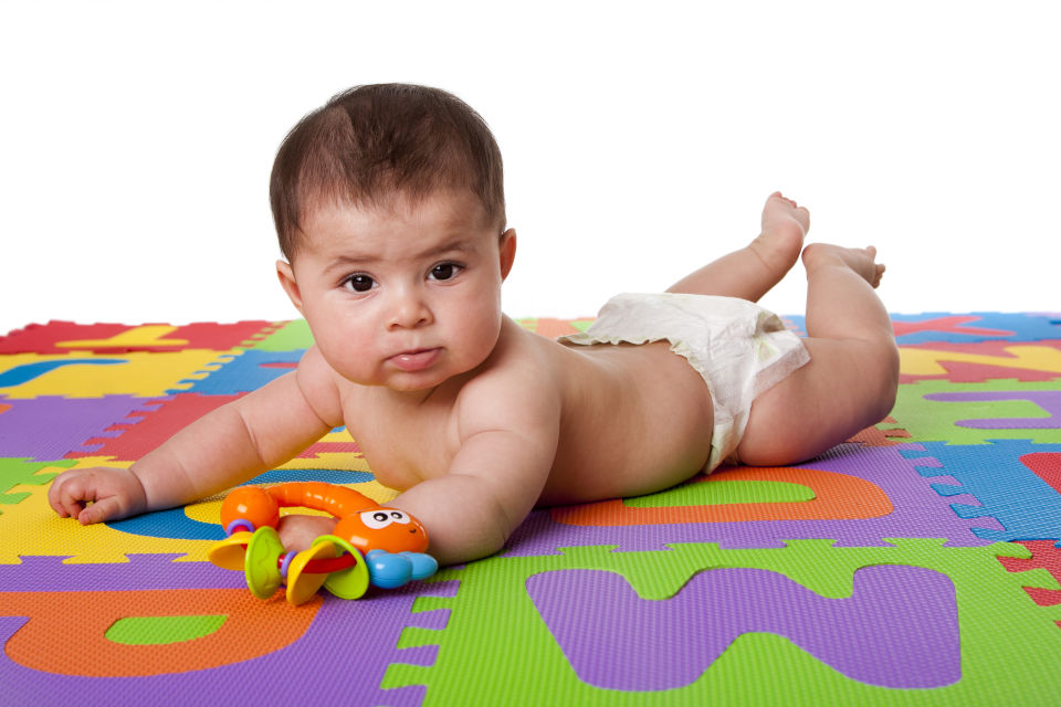 Baby Laying on Colorful Foam Mat