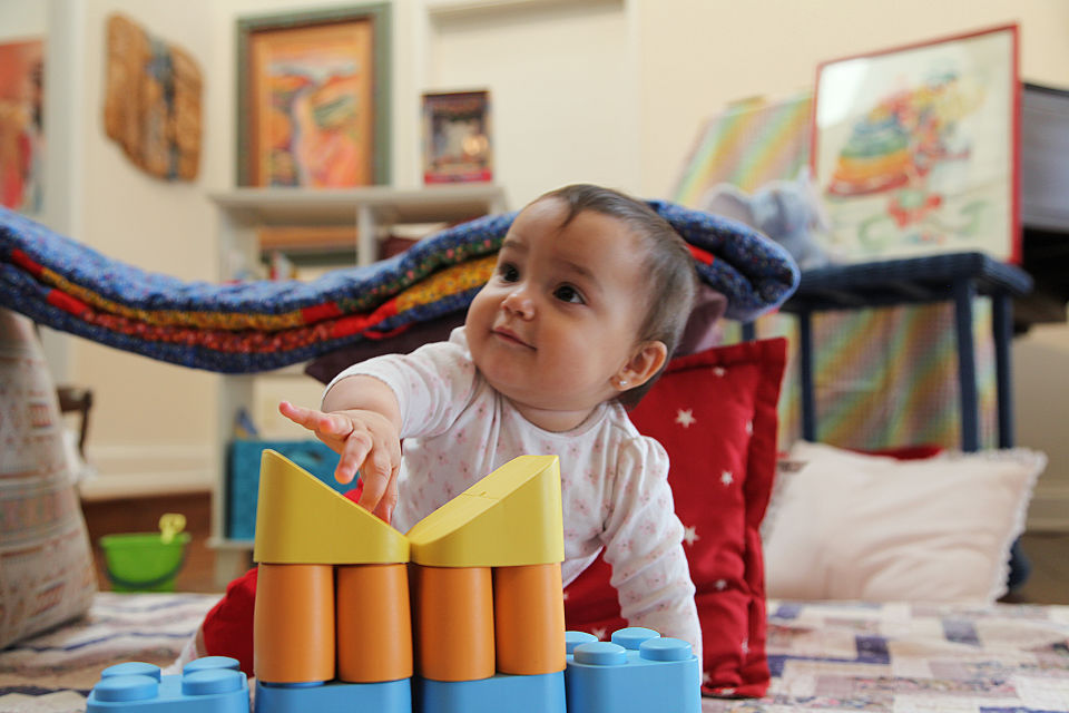 Baby pointing at toy blocks