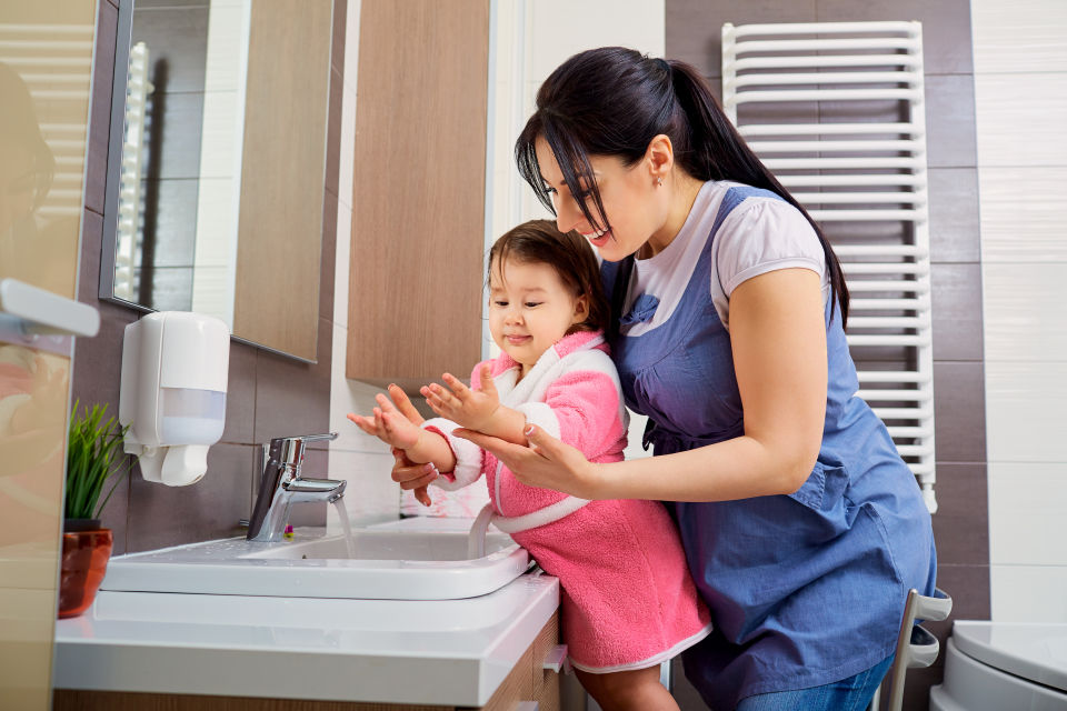 Mother and Daughter washing hands together